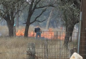 Ed helps fight a Texas size grass fire