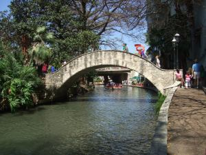 A section of San Antonio's beautiful Riverwalk in the midst of a bustling downtown